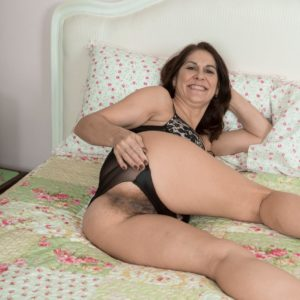 Brown-haired MILF Kaysy releasing tiny hooters and wide open muff from uber-sexy lingerie
