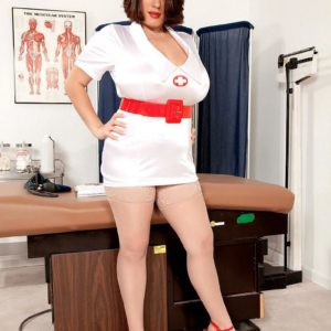 Dark-haired nurse Elaina Gregory flashing her gigantic bum and furry cooter in uniform