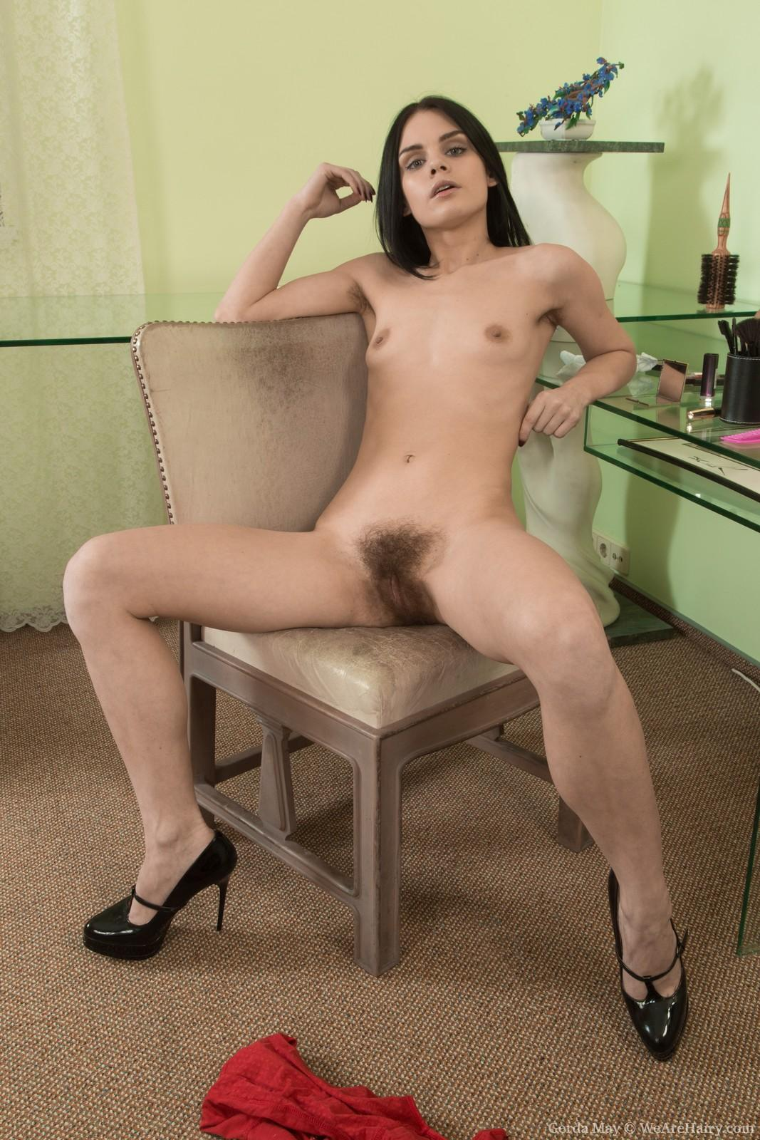 Euro brown-haired Gerda May freeing puny boobs and fur covered cooch in stilettos