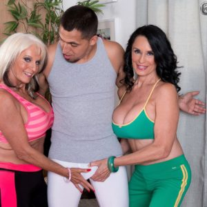 Grandma porn industry stars Sally D'Angelo and Rita Daniels press huge hooters together in Threesome