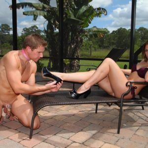 High heel and swimsuit attired authoritative type wife Callie Calypso receiving foot worship from slave