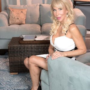 Lanky over Sixty platinum-blonde MILF Erica Lauren revealing monster-sized mature breasts and smooth-shaven cunny