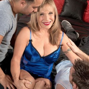 Lingerie outfitted golden-haired grandma Luna Azul pulling out giant breasts before MMF Three way sex