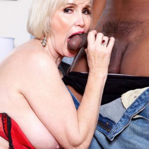 Nylon and lingerie garmented grandma Lola Lee giving massive ebony cock BJ with large titties out