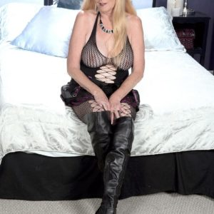 Over 60 golden-haired MILF pulling out hefty natural knockers in torn pantyhose and lengthy boots
