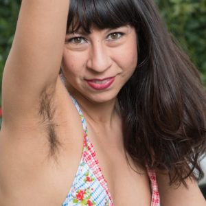 Brown-haired solo chick Vivi Marie flaunting fur covered armpits and spread fuckbox outdoors