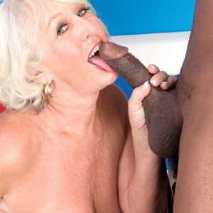 Light-haired granny Jeannie Lou delivering monster-sized black junk multiracial oral sex in lingerie