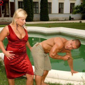 Platinum-blonde MILF Lucy Love exposing huge fun bags for tit slurping from ebony stud by pool
