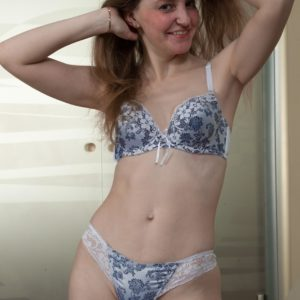 Puny titted amateur taking off lingerie before unleashing unshaven coochie