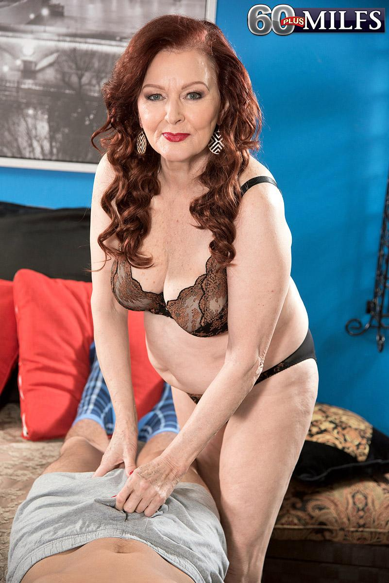 Redheaded sixty plus MILF prostitute Katherine Merlot giving monster-sized knob hand job and oral job
