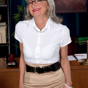 Aged office employee Cheyanne tempts the janitor in a micro-skirt and glasses