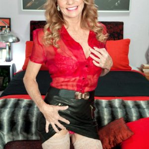Alluring old gal Denise Day entices a junior stud in leather skirt and hose