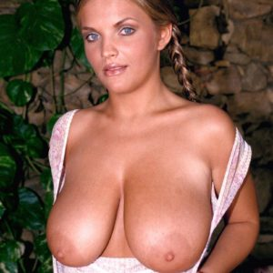 Ash-blonde solo model Ines Cudna unleashes her humungous titties with hair up in braids