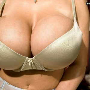 Blond MILF Crystal Gunns unveiling big melons in pantyhose and pumps