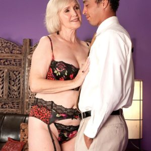 Bosomy aged XXX star Lola Lee giving blowjobs in hose and lingerie