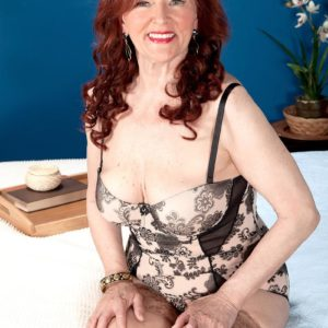 Busty ginger-haired grannie Katherine Merlot delivering hefty wood blowjob in nylons