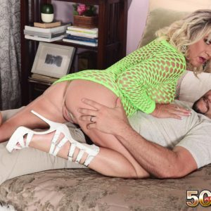 Golden-haired cougar Brandi Jaimes seduces a man in a semitransparent fishnet sundress and high-heeled shoes