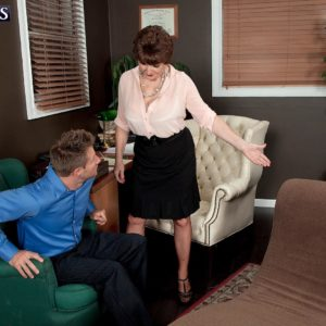 Over 60 MILF Bea Cummins letting monster-sized all-natural knockers fall loose in miniskirt and high-heels