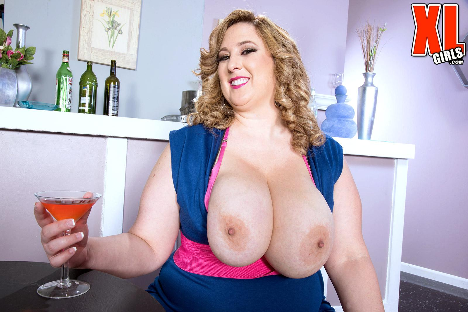 Platinum-blonde big beautiful woman Amiee Roberts looses her huge juggs from her dress over a glass of champagne