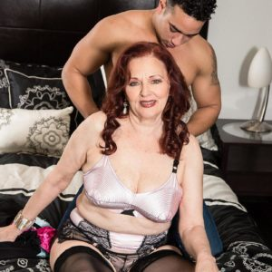 Redhead MILF over 60 Katherine Merlot unsheathing large flappy melons for nipple play