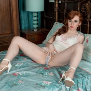 Redhead stunner Vivi St. Claire letting out unshaven ginger fuckbox from provocative lingerie