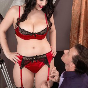 Stocking attired brunette pornostar Noelle Easton revealing nice funbags from lingerie