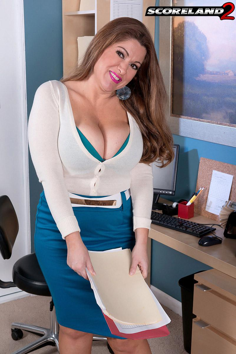 Wild platinum-blonde MILF Janessa Loren letting juggs loose from bra in home office