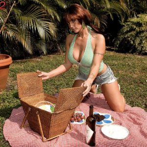 Beautiful MILF Sarah Sunshine has her immense natural hooters pawed outdoors