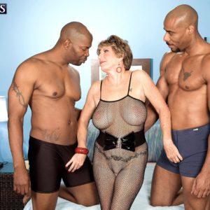Huge-boobed 60 plus MILF Bea Cummins wanking BBC in interracial Three way sex festival