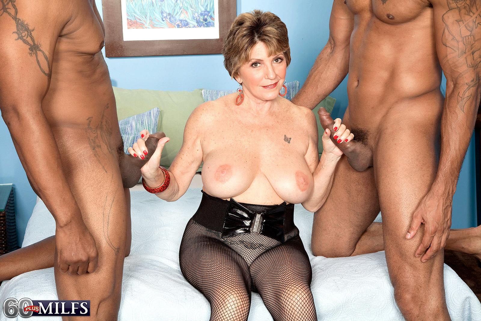 Huge-boobed 60 plus MILF Bea Cummins wanking BBC in interracial three way sex festival