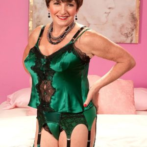 Lingerie and stocking clad Sixty plus MILF Bea Cummins baring immense experienced tits
