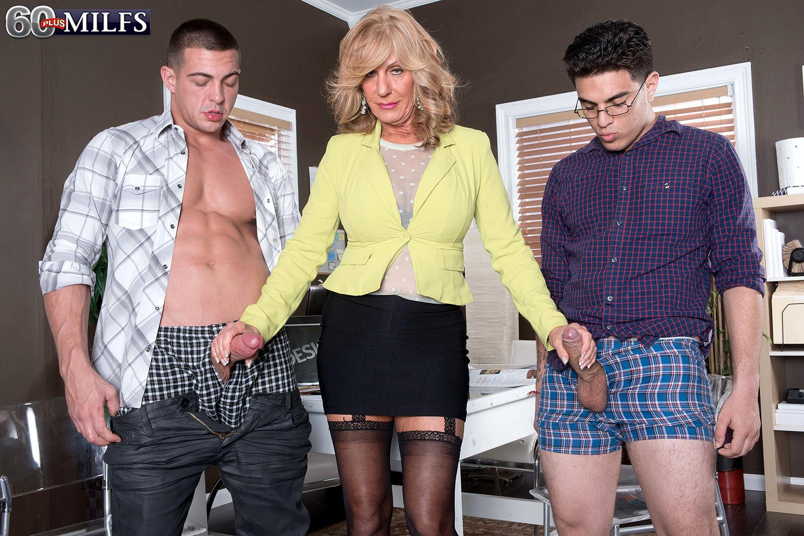 Over sixty light-haired MILF Phoenix Skye fellating big cocks in MMF 3 way