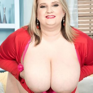 Plus sized fair-haired girl Porsche Dali reveal her gigantic boobs as she strips to her pinkish panties