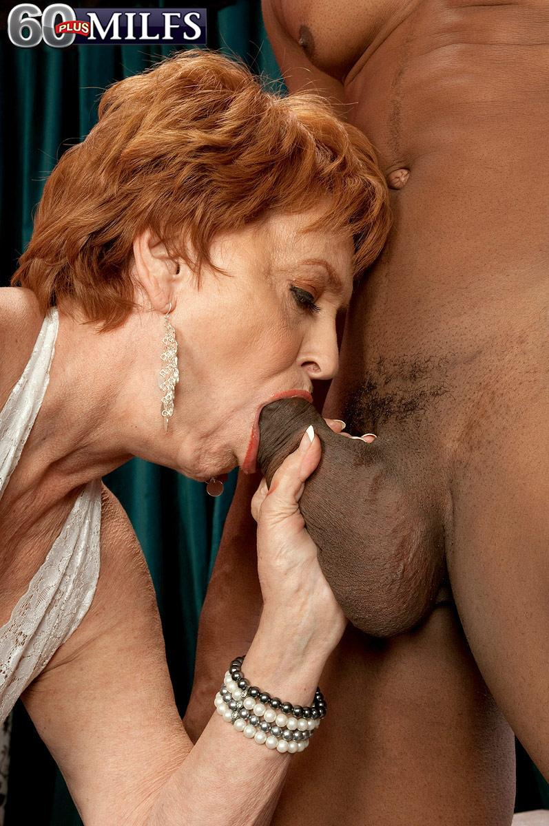 Red hair granny pornographic star Valerie blowing a monster-sized black prick in white lingerie