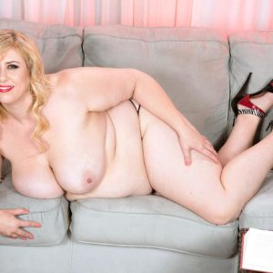 Sandy-haired BIG SEXY WOMAN Lila Lovely unsheathes her boobies as she removes her dress