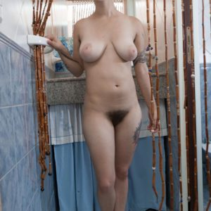 Short haired natural first-timer chick Sue demonstrating hairy pits and vag