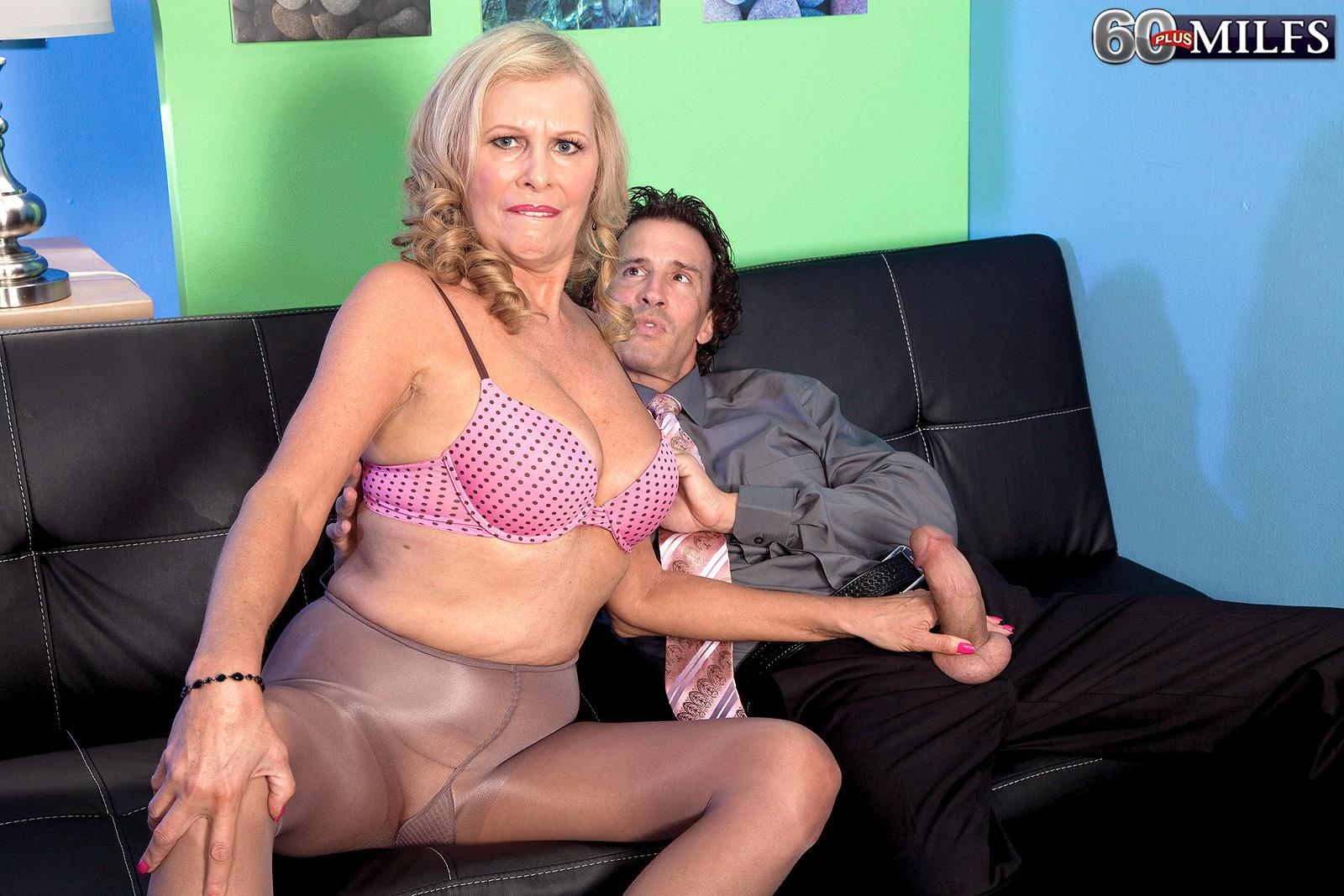 Bosomy light-haired MILF over 60 Bethany James delivering big penis oral job in office
