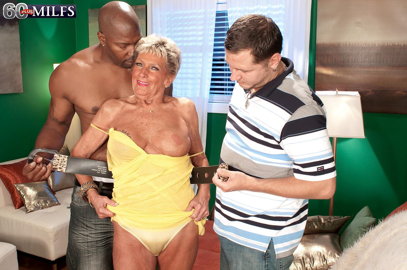 Busty over seventy grannie Sandra Ann disrobed for multiracial MMF three-way sex