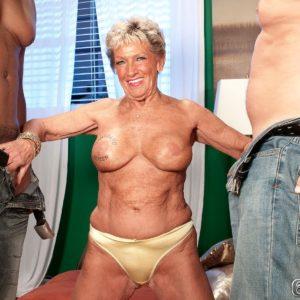 Busty over Seventy grannie Sandra Ann disrobed for multiracial MMF three-way sex