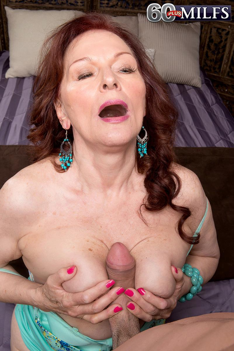 Chesty ginger-haired MILF over sixty Katherine Merlot providing monster-sized pecker titjob in hosiery