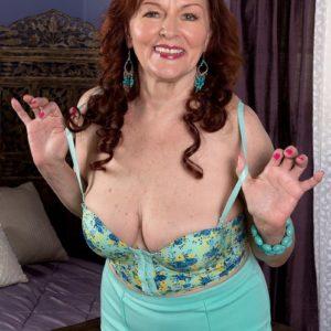 Chesty ginger-haired MILF over Sixty Katherine Merlot providing monster-sized pecker titjob in hosiery