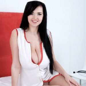 Dark-haired nurse Sha Rizel removes her uniform to pose in her melon-holder and underwear