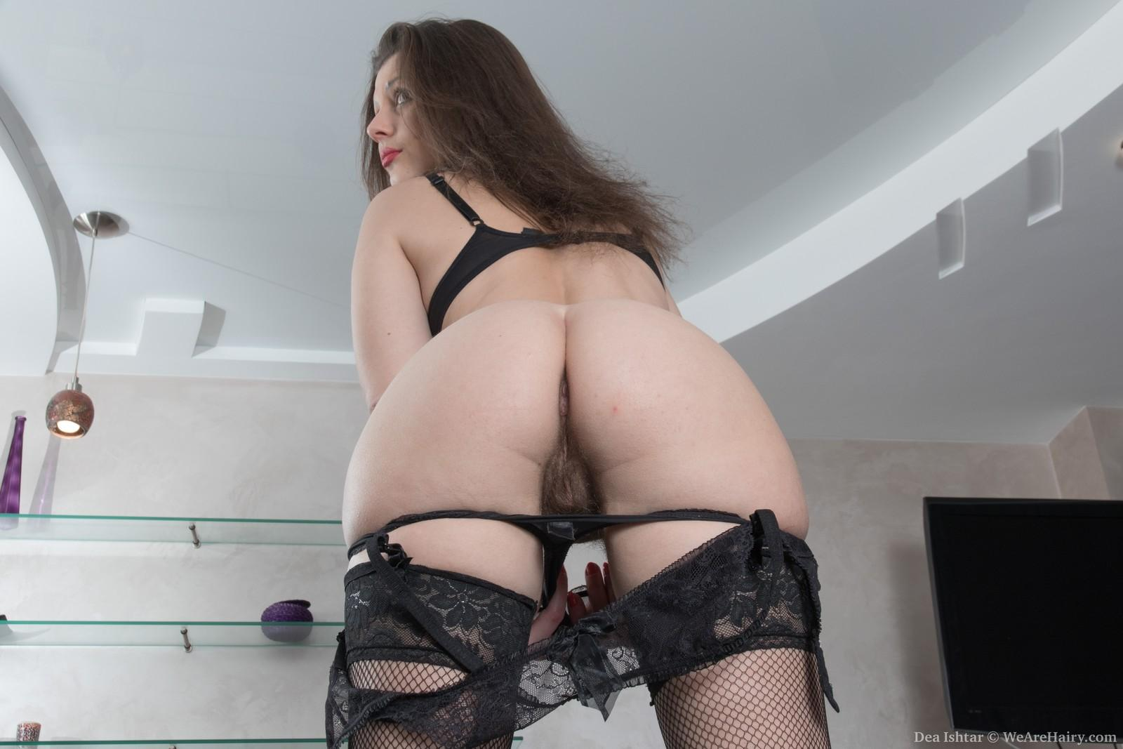 European black-haired amateur Dea Ishtar opening up hairy vag in hose and high-heels