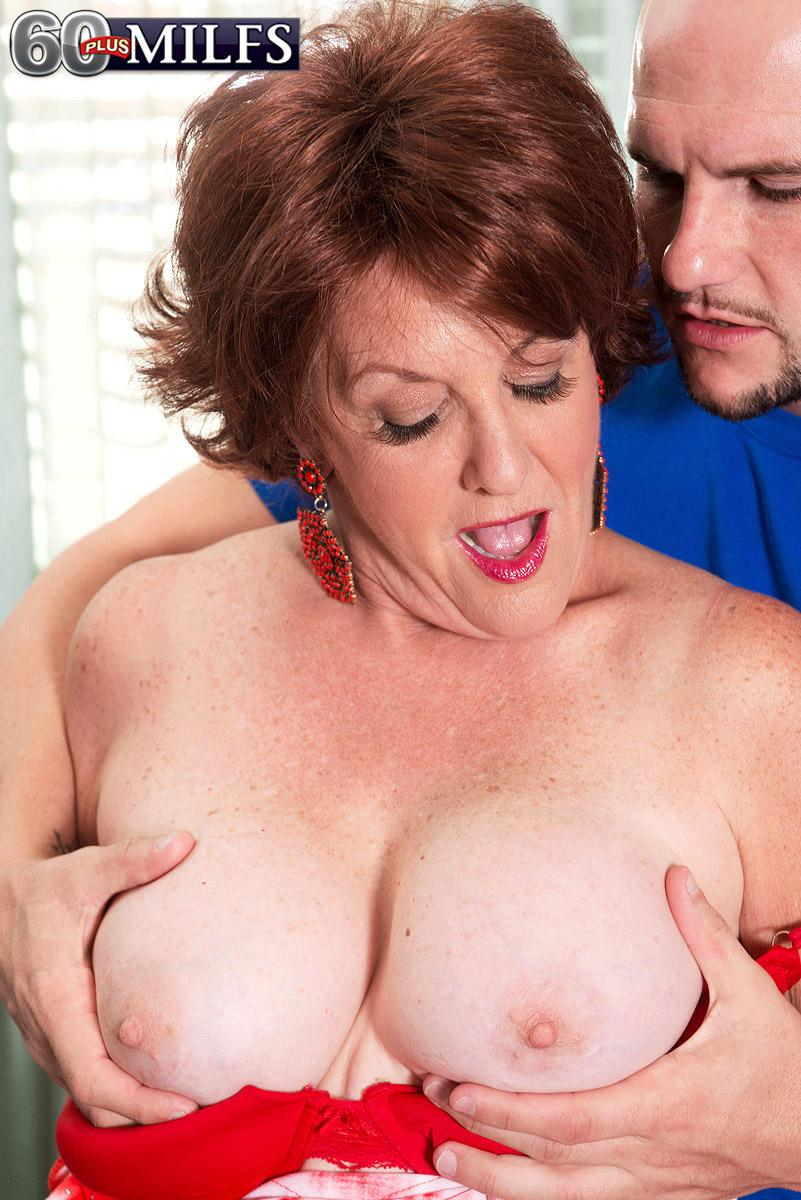 Mature Euro doll Gabriella LaMay revealing big funbags before giving blow-job