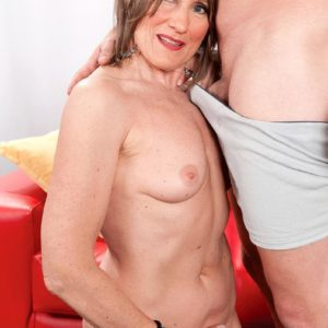 Pantyhose wearing grandma Donna Davidson undressed for sex by younger guy