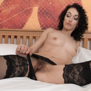 Brunette amateur Cleo Desire baring spectacular gams from hosiery before parting slit