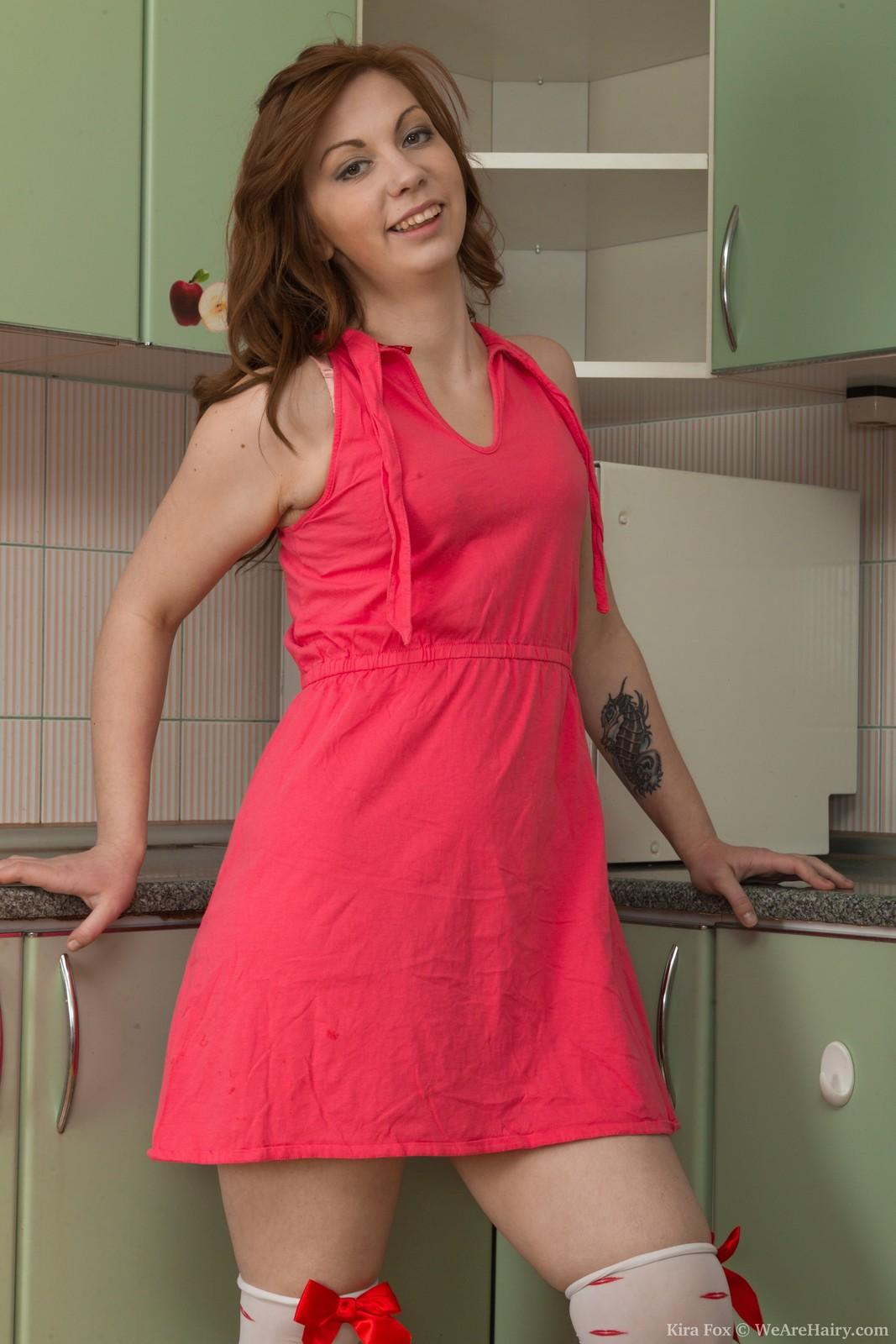 Lengthy sock garmented first-timer Kira Fox extracting diminutive knockers and fur covered snatch in kitchen