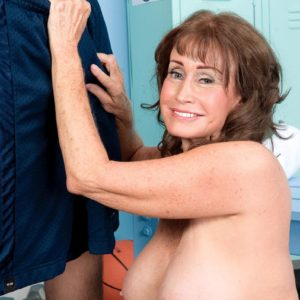 Over Sixty MILF Jacqueline Jolie flashing ass in shorts while pulling out humungous experienced boobs