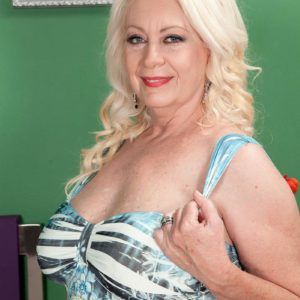 Round light-haired MILF over 60 Angelique DuBois baring pierced erect nipples and monster-sized boobs