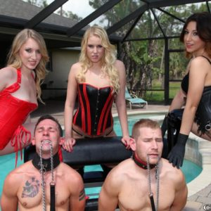 3 Dominatrixes in fetish garment abuse 2 collared male subs on the pool patio